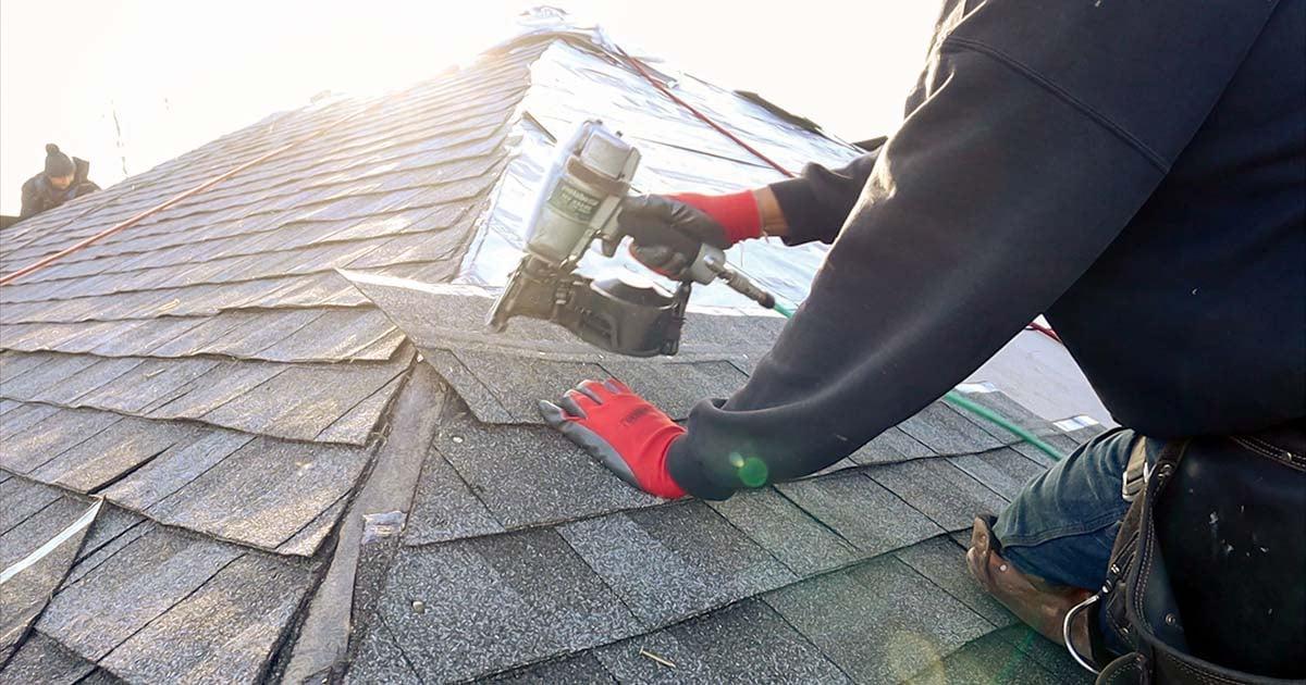 roofer installing gaf shingles